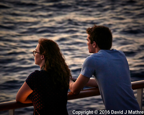 Students waiting for the sun to rise. Aft deck of the MV World Odyssey. Semester at Sea. Spring 2016 Semester Voyage -- Day 15. Crossing the Pacific Ocean from Hawaii to Japan. Image taken with a Nikon 1 V3 camera and 70-300 mm VR lens (ISO 800, 112 mm, f/5.6, 1/60 sec). Raw image processed with Capture One Pro, noise reduction with Topaz DeNoise 5 (David J Mathre)