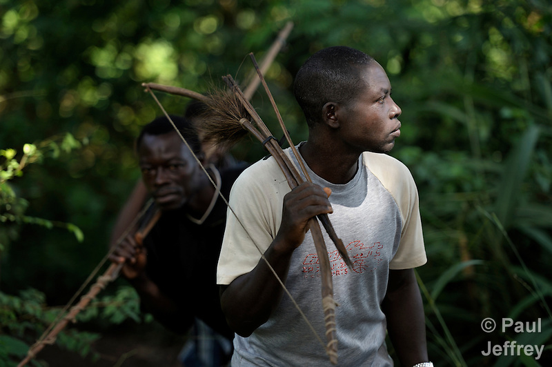 Simon Peter Gamana (right) and Charles Gorden patrol the forest near their village of Riimenze, in Southern Sudan's Western Equatoria State, on the look out for the Lord's Resistance Army, which has displaced tens of thousands in recent months along the border area. Many believe the northern Sudan government is behind the attacks in its desire to destabilize the south in the period leading to a January 2011 referendum on secession. NOTE: In July 2011 Southern Sudan became the independent country of South Sudan. (Paul Jeffrey)
