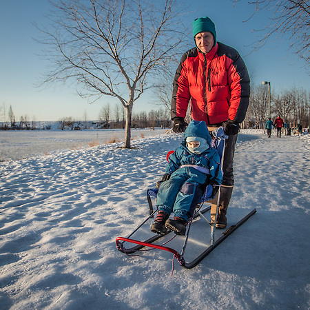 """We went out for a walk and Talvin fell asleep.""  ""Anchorage is a real jack-pot for a guy like me…lot's to do out of doors.""  -David Wigglesworth with his seven year old son at Westchester Lagoon, Anchorage (© Clark James Mishler)"