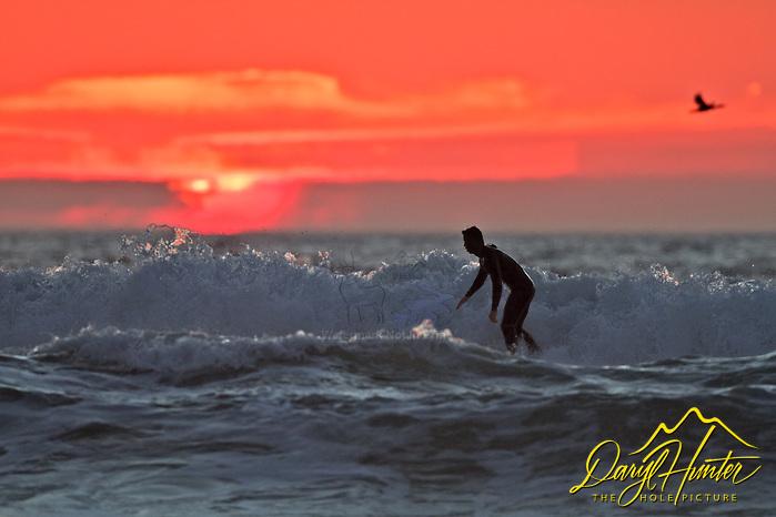 Last wave, sunset, Morro Bay, California