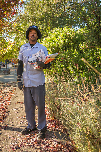 """ I think working in this community is nirvana...what's not to like.""   -Fairfield resident and mail carrier Earl Jenkins walks his route on Cedar Street in Calistoga (Clark James Mishler)"