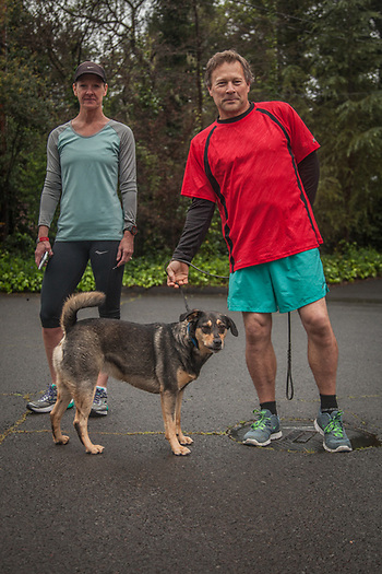 Susie Waugh and friend Mike Salling with his dog, Shelby, are about to head out for a morning run on a wet morning in Calistoga (Clark James Mishler)