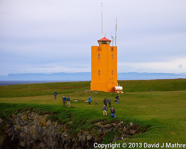 Lighthouse, Photographers, and Puffins on the Cliff at Cape Ingolfshofdi (Ingólfshöfði). A private nature preserve on an isolated headland on the coast half way between Skaftafell in Vatnajokull National Park and Jökulsárlón ice lagoon in Iceland. Composite of 3 images taken with a Nikon D4 camera and 80-400 mm VRII lens (ISO 250, 80 mm, f/4.5, 1/1000 sec). Nikonians Academy Iceland Photo Adventure. (David J Mathre)