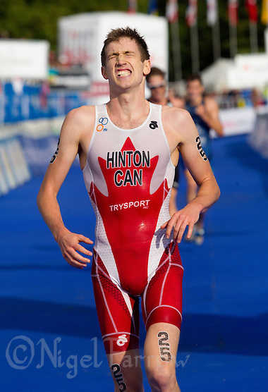 12 SEP 2013 - LONDON, GBR - Alexander Hinton (CAN) of Canada finishes the under 23 men's ITU 2013 World Triathlon Series Grand Final in Hyde Park, London, Great Britain (PHOTO COPYRIGHT © 2013 NIGEL FARROW, ALL RIGHTS RESERVED) (NIGEL FARROW/COPYRIGHT © 2013 NIGEL FARROW : www.nigelfarrow.com)