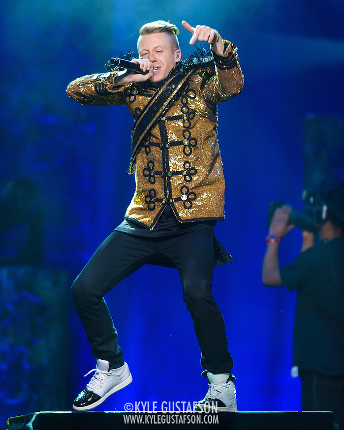 "WASHINGTON, DC - November 18, 2013 - Macklemore performs at the Verizon Center in Washington, D.C. The Heist, his 2012 album with producer Ryan Lewis, contained the #1 singles ""Thrift Shop"" and ""Can't Hold Us."" (Photo by Kyle Gustafson / For The Washington Post) (Kyle Gustafson/For The Washington Post)"
