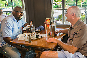 Alton Hardy, pastor of Urban Hope Community Church in Fairfield, and Bob Flayhart, pastor of Oak Mountain Presbyterian Church in Birmingham, talk during breakfast at Cracker Barrel, July 17, 2015, in Birmingham, Ala. Hardy and Flayhart began having weekly breakfasts together more than two years ago — a move they say has been instrumental in forming the trusting relationship needed as their congregations work together to heal race relations in Birmingham. (Photo by Carmen K. Sisson) (Carmen K. Sisson/Cloudybright)