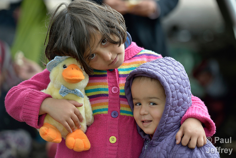 Six-year old Miriam, a refugee from Afghanistan, holds her stuffed toy duck as she embraces her little brother inside a refugee processing center in the Serbian village of Presevo, not far from the Macedonian border. Hundreds of thousands of refugees and migrants--including many children--have flowed through Serbia in 2015, on their way from Syria, Iraq and other countries to western Europe. Parental consent obtained. (Paul Jeffrey)