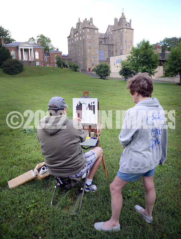"Addie Hocynec, right, of Lansdale, Pennsylvania and a painter herself, speaks with fellow artist John Schmidtberger, left, as he paints a picture during the first ever Bucks County Plein Air Festival Wednesday June 8, 2016 at the Mercer Museum in Doylestown, Pennsylvania. The competitively-selected artists will paint outdoors ""en plein air"" or ""in open air"" over the course of three days in various locations throughout the county to create various landscapes and streetscapes. (Photo by William Thomas Cain) (William Thomas Cain)"