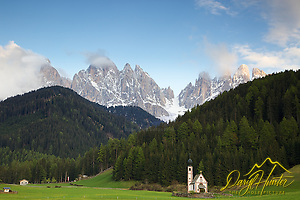 "Church at Val di Funnes in Dolomite Mountains, South Tyrol, Italy. The jagged peaks of the Olde Range tower over the valley. (© Daryl Hunter's ""The Hole Picture""/Daryl L. Hunter)"