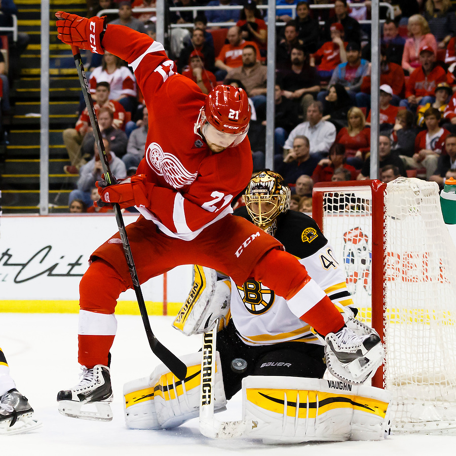 Apr 2, 2015; Detroit, MI, USA; Detroit Red Wings left wing Tomas Tatar (21) leaps over a shot puck in front of Boston Bruins goalie Tuukka Rask (40) in the third period at Joe Louis Arena. Boston won 3-2. Mandatory Credit: Rick Osentoski-USA TODAY Sports (Rick Osentoski/Rick Osentoski-USA TODAY Sports)