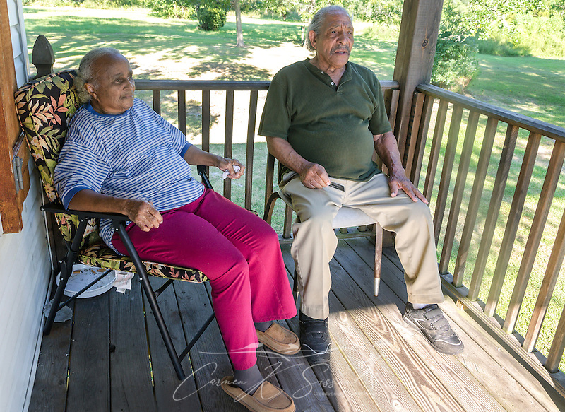 Mary and Thomas Robinson sit on their porch, Aug. 28, 2015, in Pass Christian, Mississippi. Mrs. Robinson's brother, Arthur Meunier III, drowned during Hurricane Katrina in 2005. The Robinsons home was destroyed, but they have since rebuilt. (Photo by Carmen K. Sisson/Cloudybright) (Carmen K. Sisson/Cloudybright)