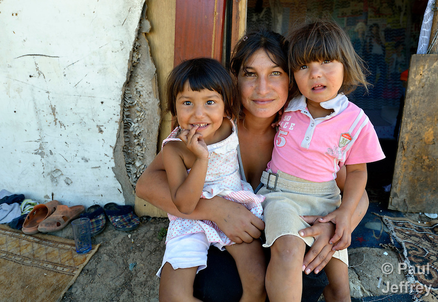 Mirjava Memetovic holds her daughters Kristina (left) and Laura, in front of their makeshift home in Palilula, a neighborhood of Belgrade, Serbia. They are Roma, also known as Gypsies, and were expelled in 2012 from the center of Belgrade to make way for new apartments and office buildings. Because Memetovic had no identity documents, she was sent with her daughters to her native village in the south of the country, but soon returned as she had no way to survive there. She and her daughters beg for money at a fast food restaurant near their squatter settlement. (Paul Jeffrey)