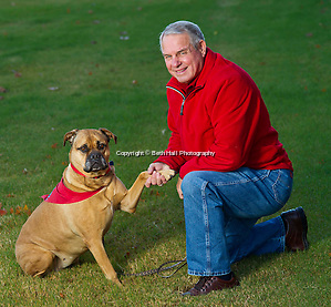 Former Razorback head coach Ken Hatfield with his dog Margo on Friday, November 8, 2013, in Fayetteville, Ark. Photo by Beth Hall (Beth Hall)