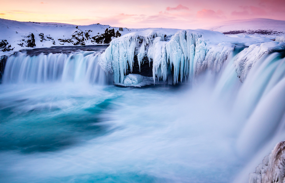 ICELAND - CIRCA MARCH 2015: Godafoss waterfall in winter. Also known as waterfall of the gods, is one of the most spectacular waterfalls in Iceland. (Daniel Korzeniewski)