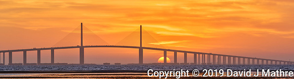Sun rising under the Sunshine Skyway bridge from Fort De Soto Park. Composite of 4 images taken with a Fuji X-H1 camera and 200 mm f/2 OIS lens with a 1.4x teleconverter (ISO 400, 280 mm, f/16, 1/80 sec). Raw images processed with Capture One Pro and AutoPano Giga Pro. (DAVID J MATHRE)