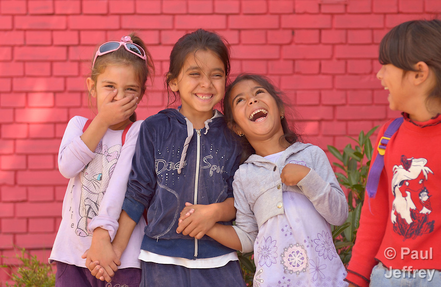 Roma girls laughing in the Nasa Radost preschool in Smederevo, Serbia. (Paul Jeffrey)
