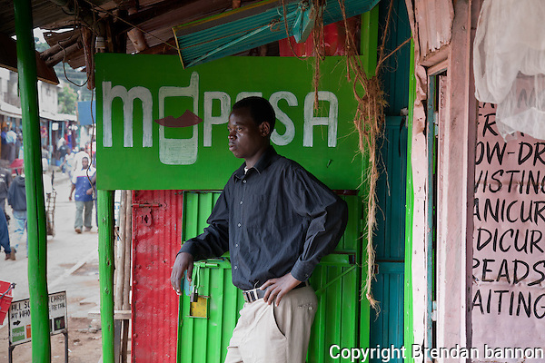 "Washington Akongo, 25, opened his mobile money transfer agency in Nairobo's Kibera slum four weeks ago. In the evenings, he's studying for his accountancy exams. ""I dream of being a CEO of Kenya's biggest banks,"" he says. (brendan bannon)"