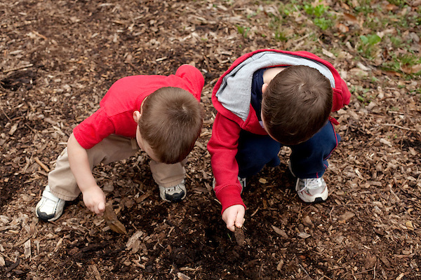 Both of my sons, then ages two and five, stop mid-hike to dig in the dirt at Lincoln Memorial Gardens in Springfield, Ill. (Kristen Schmid)