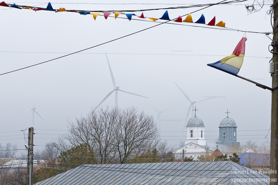 Wind turbines backdrop the small Romanian town of Fantanele. (Robert van Waarden)