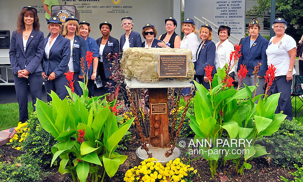 Merrick Auxiliary Unit of Merrick Post 1282 of American Legion, (left to right) Margaret Beigelman, Debra Bernhardt, Claudia Borecky, Florence Hoffman, Delores Parsons, Bridee Tonn, Lucy Murphy, Dianne Cancro, Pat Tropea, Sharon Williams, Betty Tucker, Barbara Byrne, and Fay Ambrosino, at 9/11 event dedicating monument with steel from site of World Trade Center, at Merrick Veterans Memorial Park, Merrick, New York, USA, on September 11, 2011. Photo © 2011 Ann Parry/Ann-Parry.com (Ann Parry/Ann Parry, Ann-Parry.com)