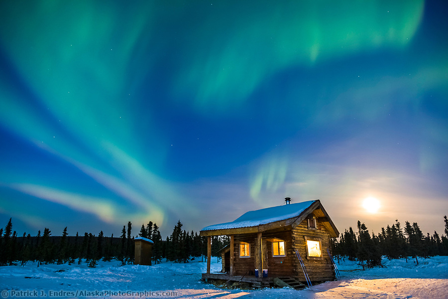 Aurora Borealis over Moose Creek cabin in the White Mountains National Recreation Area, Interior, Alaska. (Patrick J Endres / AlaskaPhotoGraphics.com)