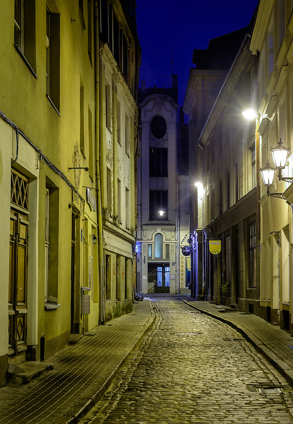 RIGA, LATVIA - CIRCA MAY 2014: View of street in Old Town Riga at night. (Daniel Korzeniewski)