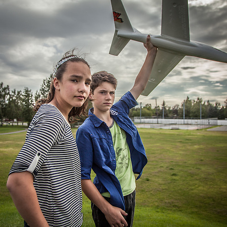 Tiernan and Connor Degnan with their model airplane on the hill at Inlet View Elementary School, Anchorage  big.con@icloud.com (© Clark James Mishler)