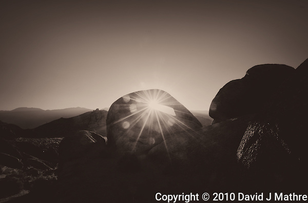 Sunrise Starburst Through Mobius Arch in the Alabama Hills near Lone Pine, California. Composite of 5 images taken with a Nikon D3x and 14-24 mm f/2.8 lens (ISO 100, 24 mm, f/22, 1/15 to 1/250 sec) processed using Photomatix Pro. Converted to B&W with Nik Silver Efex Pro 2. (David J Mathre)