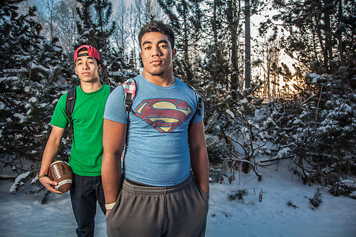 "West High School junior's Eniko Sape and John Patea on the Tony Knowels Coastal Trail, Anchorage.  ""So, you must be Superman to be out here without a coat.""  ""Yes, I would love to have super powers…we just arrived from Samoa in August…we came here for a better education and to play football.""  ""So, it's 16 degrees and you are wearing only t-shirts.  Why aren't you freezing?""  ""Super Powers!"" (© Clark James Mishler)"