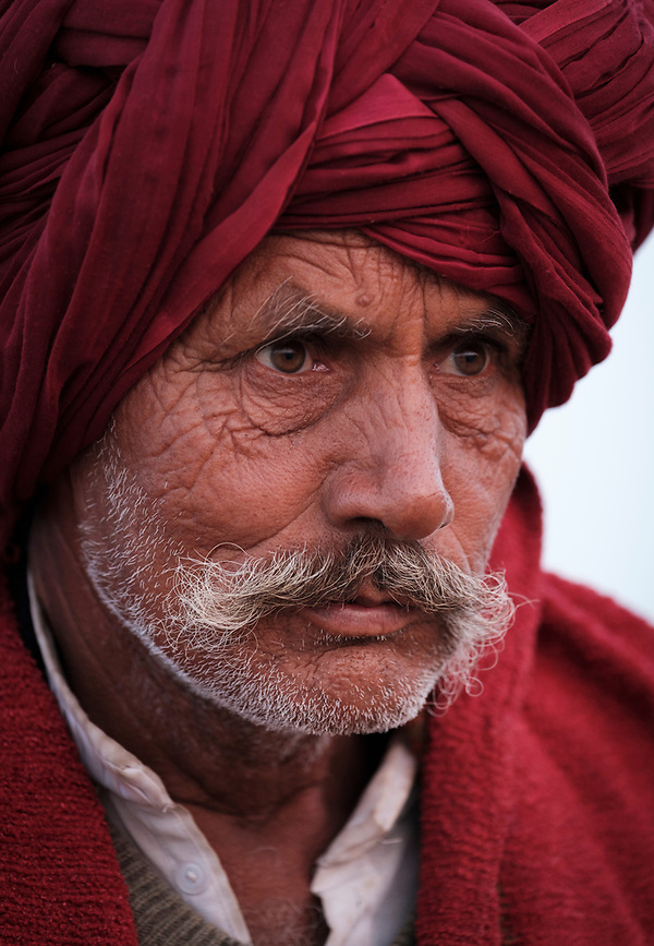 PUSHKAR, INDIA - CIRCA NOVEMBER 2016: Portrait or Rajasthani farmer at Pushkar Camel Fair grounds. It is one of the world's largest camel fairs. Apart from the buying and selling of livestock, it has become an important tourist attraction. (Daniel Korzeniewski)