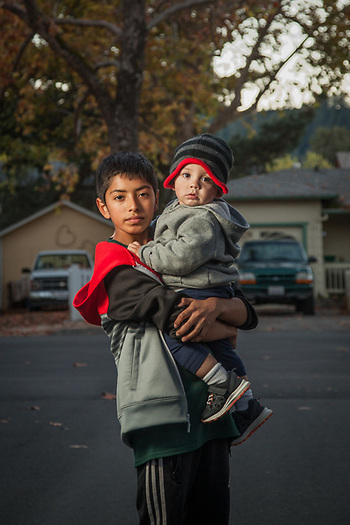 "thriteen year old Anthony Espinoza and his one year old brother, Franco, near their home in Calistoga, CA ""I want to be a lawyer some day...I like to argue."" espinoza8724@gmail.com (© Clark James Mishler)"