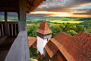 View of the church tower of the Szekly medieval fortified church of Viscri, Buneşti, Braşov, Transylvania. Started in the 1100's. UNESCO World Heritage Site (Paul E Williams)