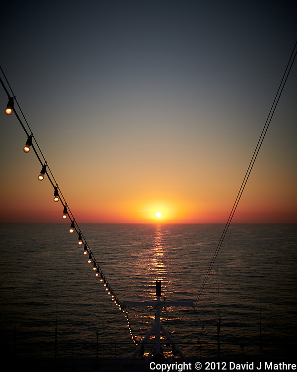 Sunrise on the English Channel from the aft deck of the MV Explorer. Image taken with a Leica X2 camera (ISO 100, 24 mm, f/5.6, 1/400 sec). (David J Mathre)