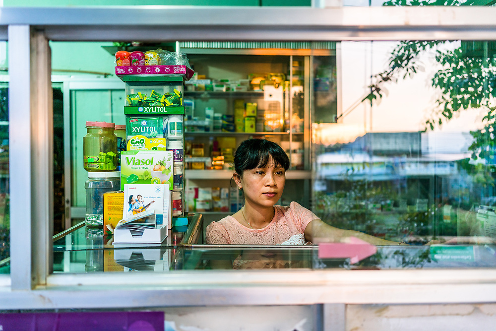 BU GIA MAP, VIETNAM – OCTOBER 6, 2017: Tra Thi Nhan, 35, owner of a small pharmacy in Bu Gia Map District in Binh Phuoc Province. Pharmacies like this are no longer permitted to sell medications for Malaria, and instead must refer to potential patients to a local hospital for diagnosis and treatment. This is done in hopes of tighter controls on Malaria medications, which in hopes will decrease the drug resistance that has become more prevalent in recent years. (Quinn Ryan Mattingly)