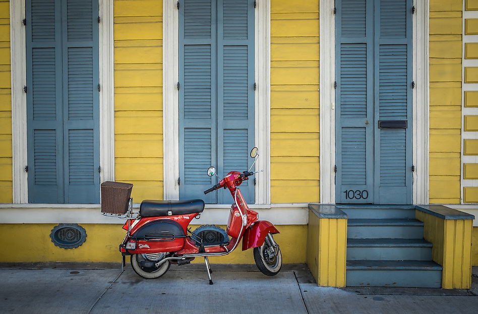 NEW ORLEANS - CIRCA FEBRUARY 2014: View of a typical facade in the New Orleans French Quarter in Louisiana, with motorcycle in the front. (Daniel Korzeniewski)
