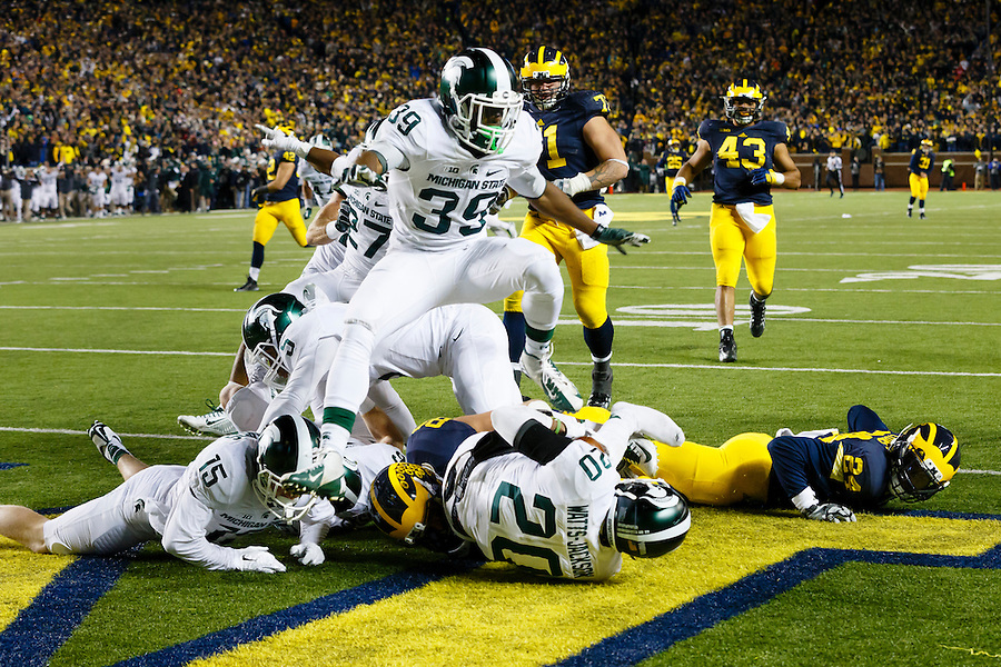 Oct 17, 2015; Ann Arbor, MI, USA; Michigan State Spartans defensive back Jalen Watts-Jackson (20) dives into the end zone for a game winning touchdown as the clock runs out in the fourth quarter against the Michigan Wolverines at Michigan Stadium. Michigan State 27-23. Mandatory Credit: Rick Osentoski-USA TODAY Sports (Rick Osentoski/Rick Osentoski-USA TODAY Sports)