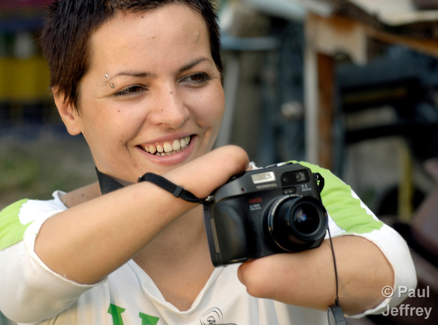 Bobana, a 26-year old woman in Gradiska, Banja Luka, Bosnia and Herzegovina. She lost her hands to an explosion of ordnance during the conflict that engulfed her country. Dedicated to photography, she hasn't let her disability stop her, and she participates actively in a local cooperative of artists who are also survivors of war-related violence.
