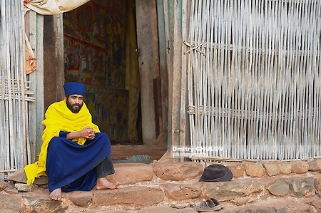 BAHIR DAR, ETHIOPIA - JANUARY 21, 2010: Unidentified priest sits at the entrance to the ancient church Ura Kidane Mehret in Bahir Dar, Ethiopia. (Dmitry Chulov)