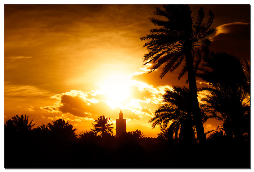 Sunset with mosque and date palms in Ouarzazate, Morocco. (Rosa Frei)