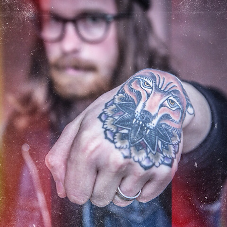"Nordstrom Visual Manager and photographer Michael James Spear with his tiger tattoo.  ""My wife and I go out for tattoos on date night."" michaeljamesspear@gmail.com (© Clark James Mishler)"