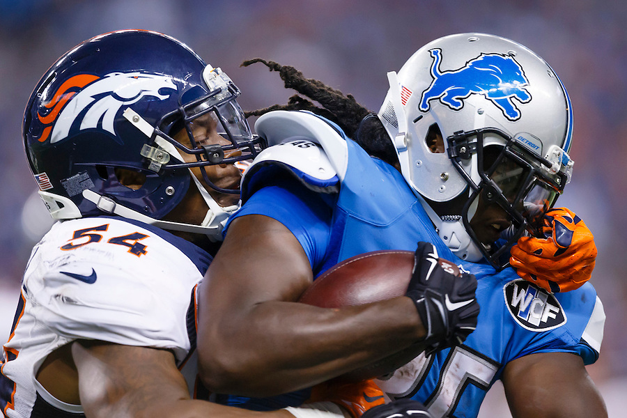 Detroit Lions running back Joique Bell (35) is tackled by Denver Broncos inside linebacker Brandon Marshall (54) during an NFL football game at Ford Field in Detroit, Sunday, Sept. 27, 2015. (AP Photo/Rick Osentoski) (Rick Osentoski/AP)