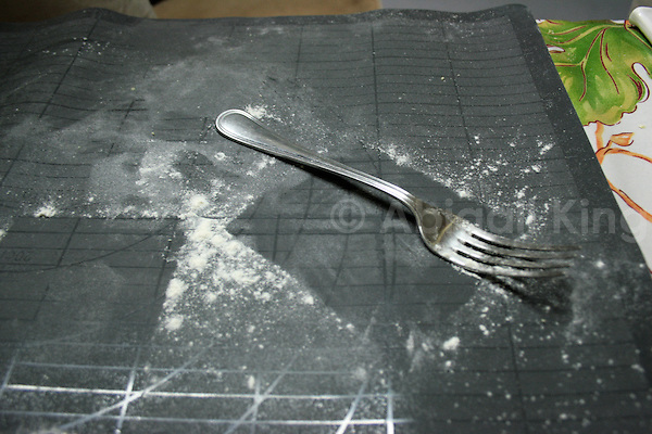 Fork and flour in Italian cooking lesson