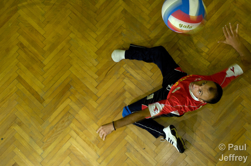 A landmine survivor, missing his right foot, serves the vall in a volleyball game in Banja Luka, Bosnia and Herzegovina. The game is organized by the Landmine Survivors Network. (Paul Jeffrey)