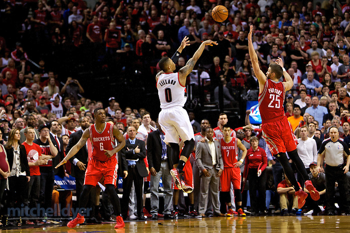 May 2, 2014; Portland, OR, USA; Portland Trail Blazers guard Damian Lillard (0) makes a three pointer at the buzzer over Houston Rockets forward Chandler Parsons (25) to win the game during the fourth quarter in game six of the first round of the 2014 NBA Playoffs at the Moda Center. Mandatory Credit: Craig Mitchelldyer-USA TODAY Sports (Craig Mitchelldyer/Craig Mitchelldyer-USA TODAY Sports)