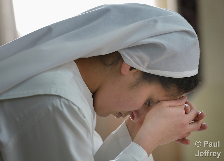 Diana Sakaria, a novice in the Dominican Sisters of St. Catherine of Siena, prays in the chapel of the congregation's convent in Ankawa, near Erbil, Iraq. The sisters were displaced by ISIS in 2014, and carry out a variety of ministries among the displaced in northern Iraq. (Paul Jeffrey)