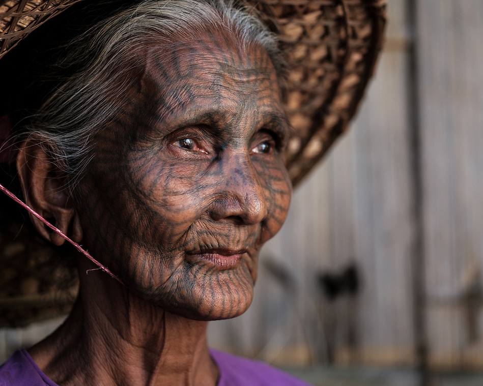MRAUK U, MYANMAR - CIRCA DECEMBER 2017: Portrait of woman with tattoo face from a Chin Village in the remote area of Mrauk U, Rakhine State. (Daniel Korzeniewski)