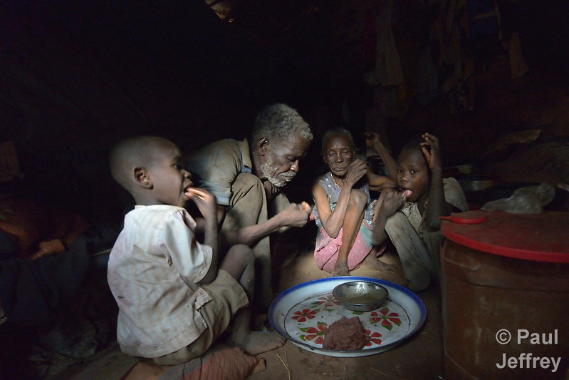 A family shares a meal inside their shelter in a camp for more than 12,000 internally displaced persons located on the grounds of the Roman Catholic Cathedral of St. Mary in Wau, South Sudan. Most of the families here were displaced in June, 2016, when armed conflict engulfed Wau. Norwegian Church Aid, a member of the ACT Alliance, has provided relief supplies to the displaced in Wau, and has supported the South Sudan Council of Churches as it has struggled to mediate the conflict in Wau. (Paul Jeffrey)