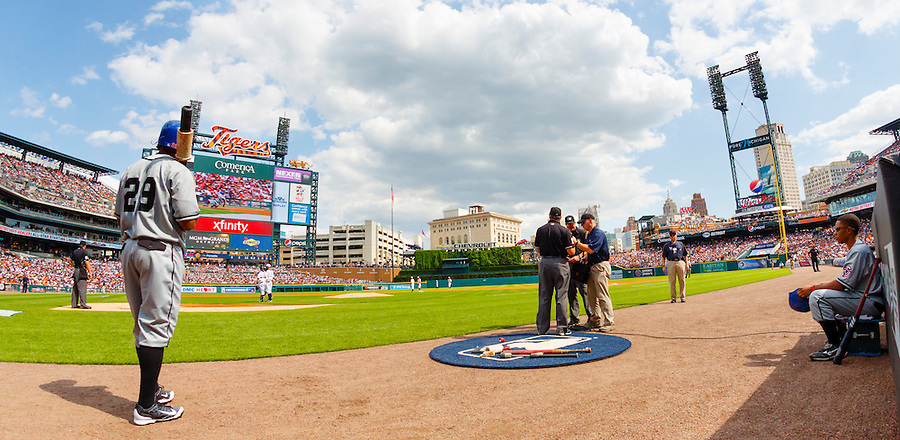 May 24, 2014; Detroit, MI, USA; Umpires (right) check with the review officials in New York during the first inning of the game between the Detroit Tigers and the Texas Rangers at Comerica Park. Mandatory Credit: Rick Osentoski-USA TODAY Sports (Rick Osentoski)