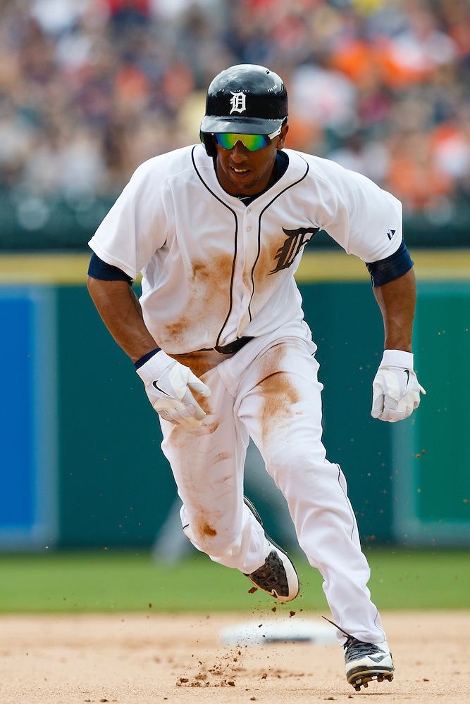 Jun 14, 2015; Detroit, MI, USA; Detroit Tigers center fielder Anthony Gose (12) runs to third in the first inning against the Cleveland Indians at Comerica Park. Mandatory Credit: Rick Osentoski-USA TODAY Sports (Rick Osentoski/Rick Osentoski-USA TODAY Sports)