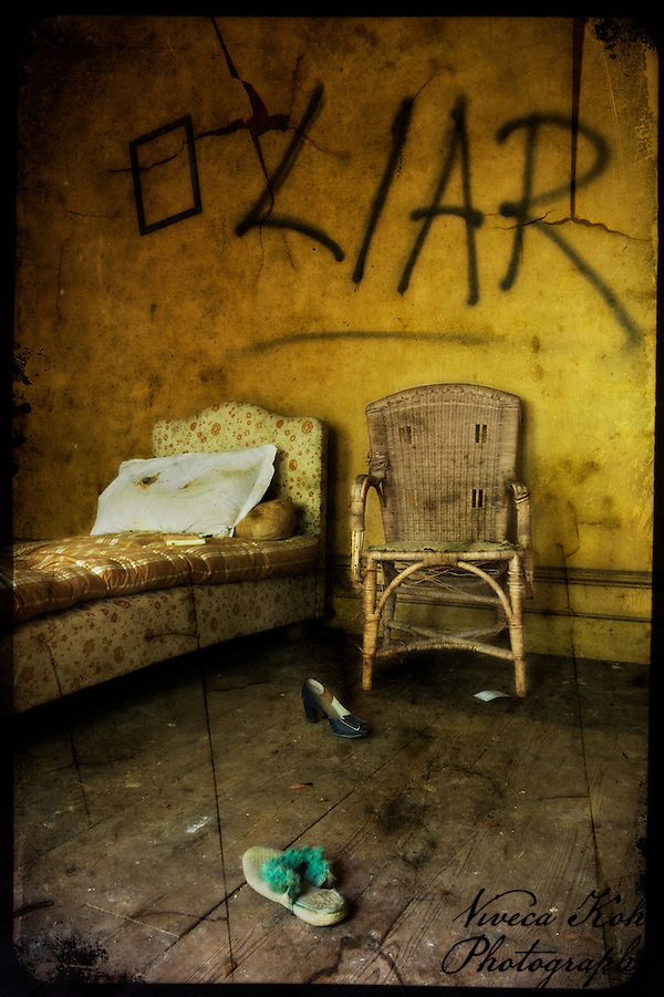 Chair and chaise longue in an abandoned bedroom (Viveca Koh)